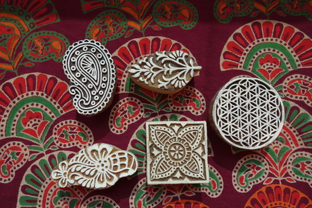 Indian wood printing blocks with block printed textile background