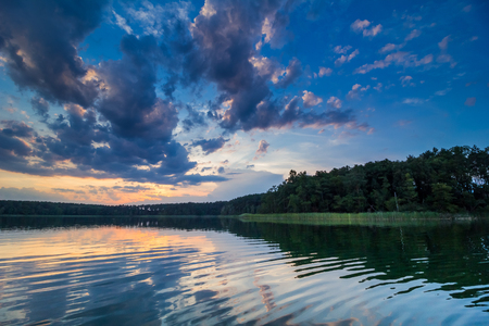 wide panorama of a beautiful, calm and wild lake in Poland