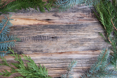 ordinary old wooden boards with twigs of pine needles (Christmas tree), background for text, simple xmas motif with natural frame Banco de Imagens - 113449859