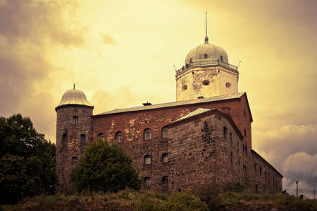 dramatically: Old Swedish fortress at Wiborg city, shooted with dramatically sunlight over the clouds Stock Photo