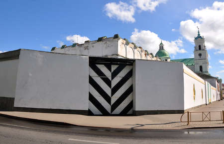 prison: The striped gate and white fence of prison in the Grodno. Belarus Editorial