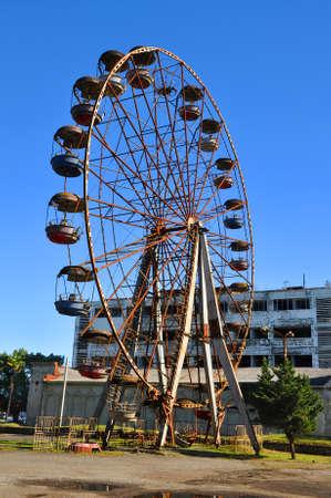 postwar: Ferris wheel is not working in Ochamchira Editorial