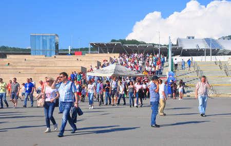 SOCHI, RUSSIA - JUNE 25, 2017: FIFA Confederations Cup 2017 in Sochi. Spectators descend the steps of the train station