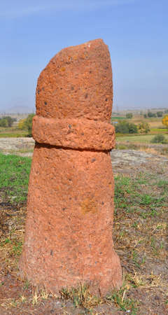 Phallic symbol (menhir) in the ancient settlement of Metsamor. Historical-archeological museum-reserve Metsamor. Armenia