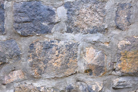 Fragment of a wall with large stones on a solution