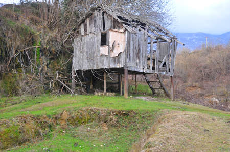The wooden building of the old watermill  in Abkhazia Stock Photo