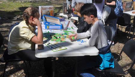 Three children play a board game on the Sochi Open Fest. SOCHI, RUSSIA 報道画像