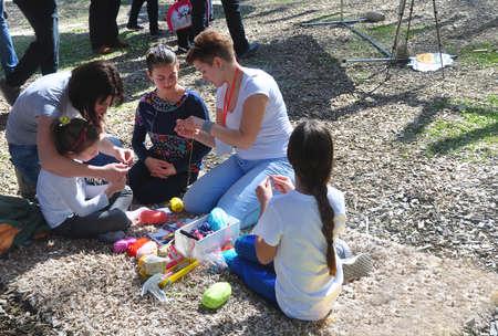 SOCHI, RUSSIA - APRIL 8, 2018: Children learn to knit at the Sochi Open Fest Festival in 2018 報道画像