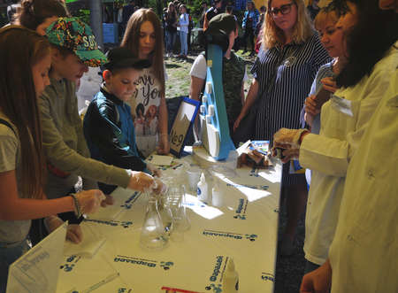 Participants of Sochi Open Fest festival through the end of 2018 conduct chemical experiments at the stand of the network of clubs of young chemists Faraday. SOCHI, RUSSIA