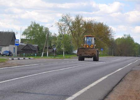 ZVENCHATKA, BELARUS - MAY 12, 2017: Tractor rides on an asphalt rural road 報道画像