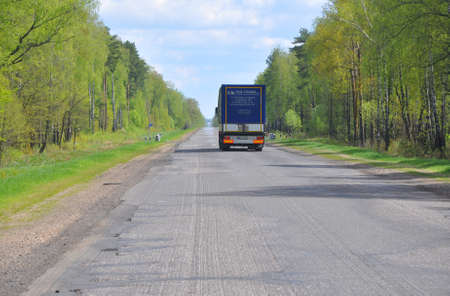 ZVENCHATKA, BELARUS - MAY 12, 2017: Polish truck rides on an asphalt road in the forest belt