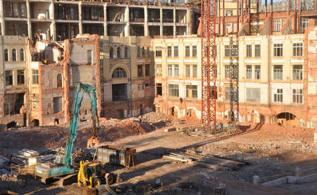"""MOSCOW, RUSSIA - OCTOBER 16, 2018: The construction site on the site of the profitable houses of Zelik Persits, the insurance company """"Yakor"""" and the partnership """"Provodnik""""."""