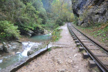 Narrow-gauge railway goes along the river Kurdzhips. Guam Gorge. Krasnodar region, Russia 写真素材
