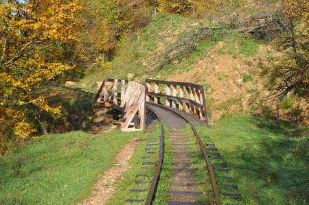 Wooden bridge on the narrow gauge road Mezmay-Guamka. Russia 写真素材
