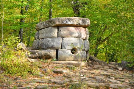 A preserved composite dolmen in the Zhane River Valley. Dolmen group Zhane I. Krasnodar region, Russia