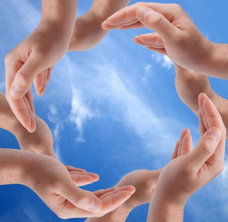 Hands sign on nature background Stock Photo - 6552745