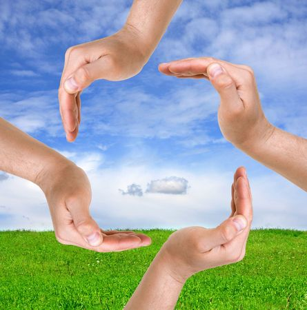 global health: Hands sign on nature background