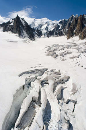 melts: The glacier melts under the summer sun in Chamonix, France.