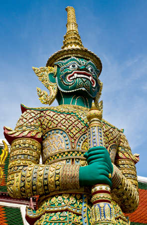 Giant standing in front of a buddhist temple, Bangkok, Thailand  Stock Photo