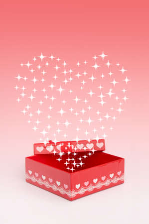 Red gift box with heart shape photo
