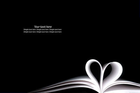white blank book pages curved modified heart shape on black background Stock Photo
