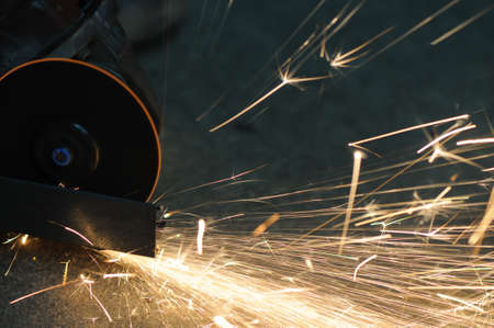 light from electric grinder cutting metal Stock Photo