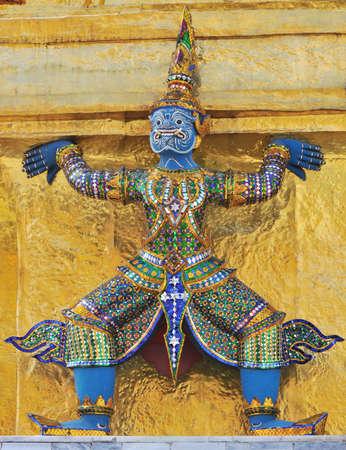 Statue Blue Giant Decorate Golden Stupa in Wat Phra Keaw, Bangkok Thailand