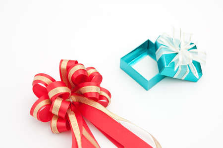 red ribbon with cyan gift box on white background