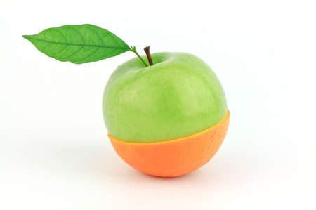 half cut: apple and orange cut in half on white background