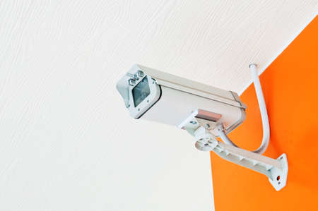 Security Camera or CCTV on Orange wall Stock Photo