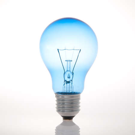 Blue light bulb on white background Stock Photo