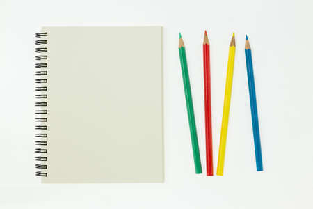 open blank page notebook with pastel on white background stock photo