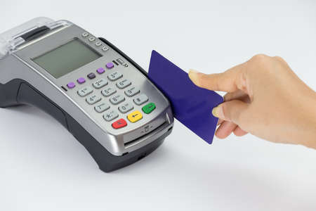 Women hand using a credit card with electronic data capture machine photo