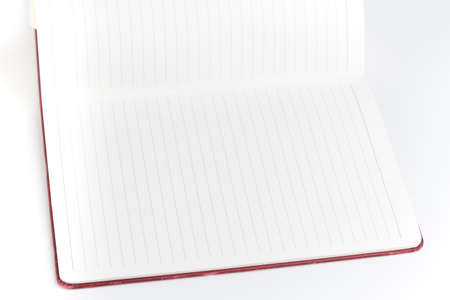 Open page red cover notebook on white background Stock Photo