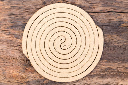 Mosquito coil on wood background Stock Photo