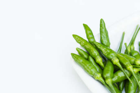 Green peppers in close up on white background