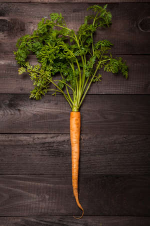 Carrot on a black wooden background photo