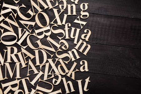 Wooden letters on dark wooden background Stock Photo