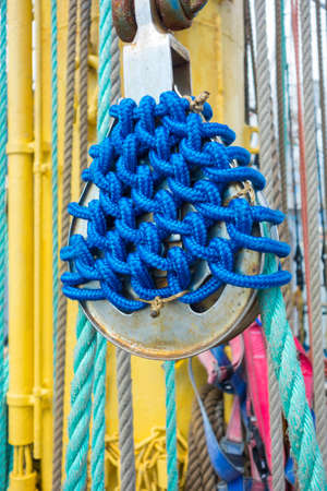 pulleys: Sea hemp ropes and pulleys on the old nautical vessel.