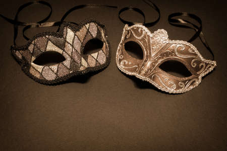 venician: Carnival masks on sepia background Stock Photo