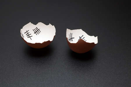Escape from the egg. Broken egg of chicken that escaped from the egg. Isolated on black background. Stock Photo