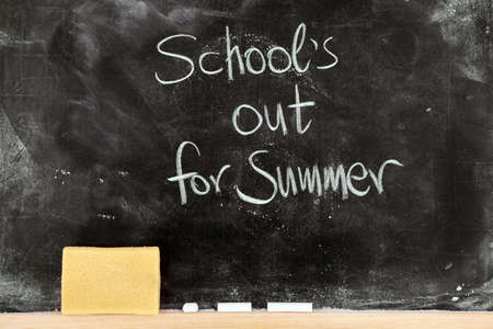 school year: Schools out for summer on blackboard