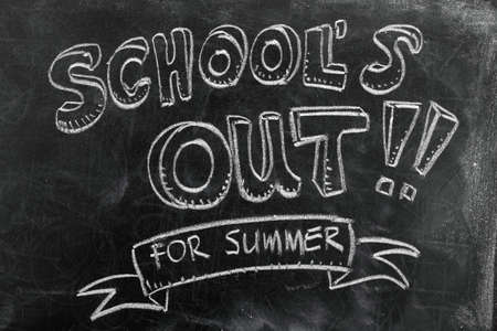 Schools out for summer on blackboard photo