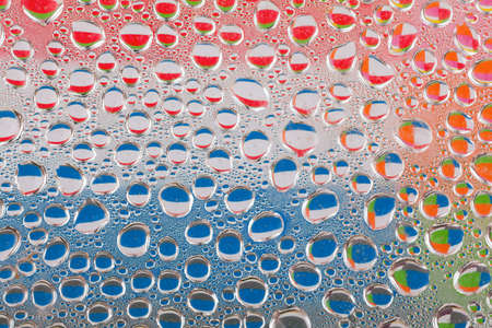 garish: Water drops of water on glass surface
