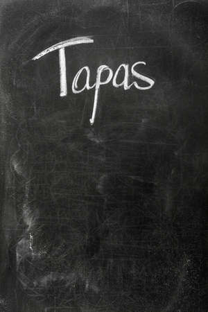 Menu on the blackboard showing what is available. Spanish tapas