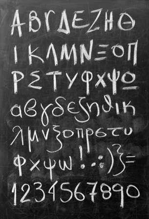 alphabet greek: Greek alphabet - white chalk handwriting on blackboard
