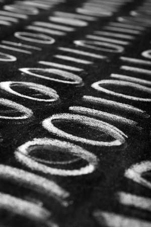 Binary code abstract - rows of zero and one numbers in white chalk handwriting on blackboard photo