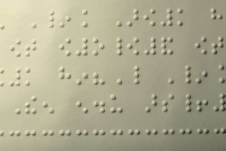 Close up of paper with braille text photo