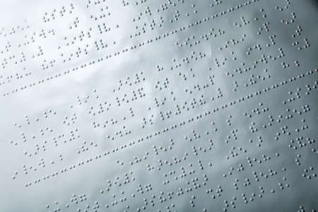 Close up of paper with braille text Stock Photo