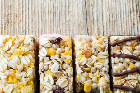 Cereal bars on a wooden table photo